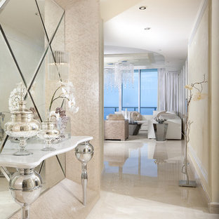Inspiration for a mid-sized contemporary marble floor and white floor foyer remodel in Miami with beige walls