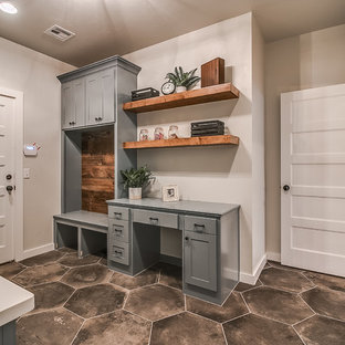 Inspiration for a large transitional ceramic floor and gray floor entryway remodel in Oklahoma City with white walls and a white front door