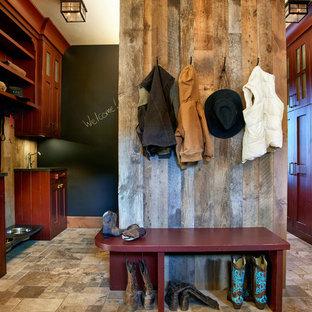 Mudroom - rustic travertine floor mudroom idea in Denver with brown walls