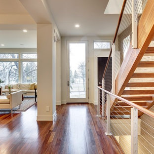 Inspiration for a mid-sized modern medium tone wood floor entryway remodel in Minneapolis with white walls and a white front door