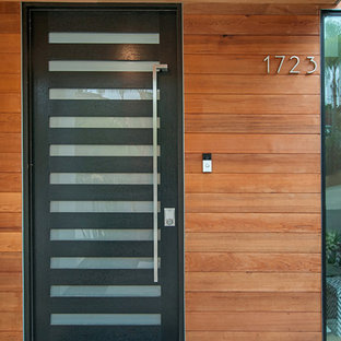 Large minimalist entryway photo in San Diego with a black front door