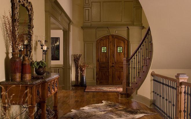 Rustic Entry by Terri Ervin Decorating Den Interiors