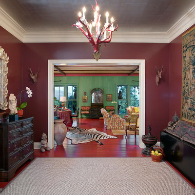Inspiration for an eclectic foyer remodel in Santa Barbara with red walls