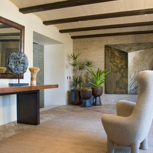 Inspiration for a mid-sized contemporary slate floor foyer remodel in Santa Barbara with white walls
