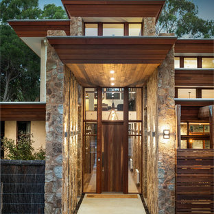 Photo of a large contemporary entryway in Melbourne.