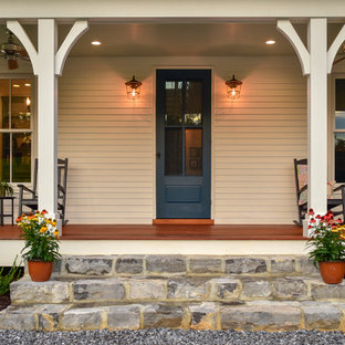 Cottage entryway photo in Other with beige walls and a blue front door