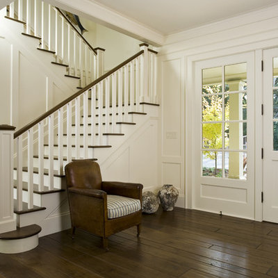 Inspiration for a timeless dark wood floor and brown floor entryway remodel in San Francisco with white walls and a white front door