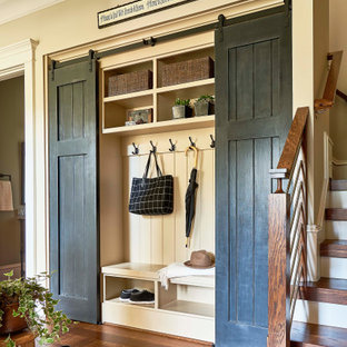 Design ideas for a rustic boot room in Raleigh with beige walls and medium hardwood flooring.