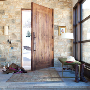 Inspiration for a transitional single front door remodel in Denver with multicolored walls and a medium wood front door