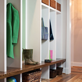 Inspiration for a rustic medium tone wood floor mudroom remodel in Richmond with beige walls