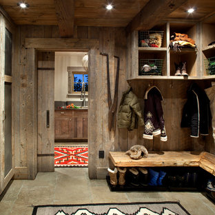 Inspiration For A Mid Sized Rustic Beige Floor Mudroom Remodel In Other With Brown Walls