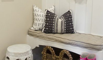 Mud room from Alice Lane Home has a built in bench with hooks and a Surya Fallon