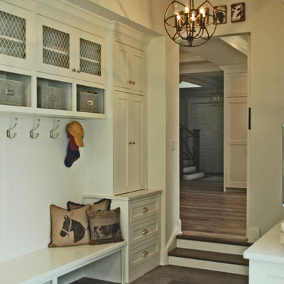 Large farmhouse slate floor mudroom photo in Chicago with white walls