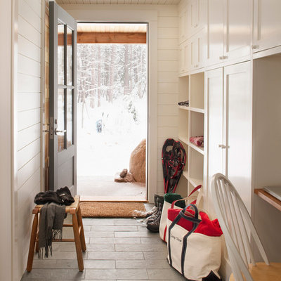 Example of a classic slate floor and gray floor mudroom design in Boston