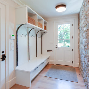 Example of a mid-sized classic light wood floor entryway design in Other with white walls and a white front door