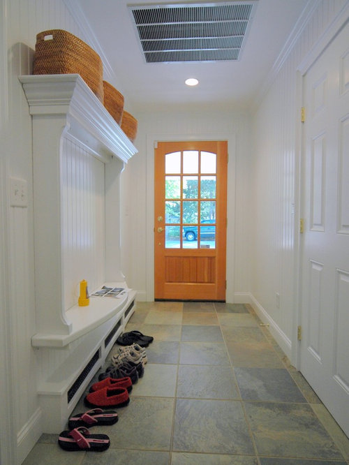 eclectic ceramic floor single front door idea in boston with white walls and a light wood
