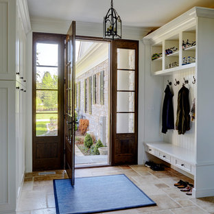Mudroom Entry with Travertine Flooring and Built-In Cabinetry with Bench Seating