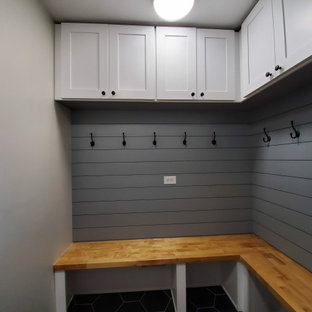 Mid-sized trendy porcelain tile and black floor mudroom photo in Chicago with gray walls