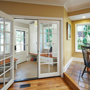 Inspiration for a mid-sized timeless medium tone wood floor and brown floor entryway remodel in Chicago with gray walls and a white front door