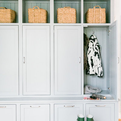 Mudroom - large cottage light wood floor mudroom idea in Baltimore with gray walls and a black front door