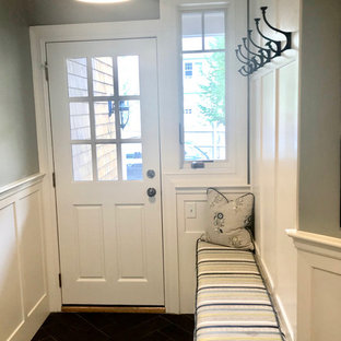 Entryway - small transitional ceramic tile and black floor entryway idea in Boston with blue walls and a white front door