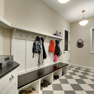 Large transitional linoleum floor entryway photo in Minneapolis with beige walls and a white front door
