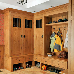 Large elegant mudroom photo in Boston with white walls