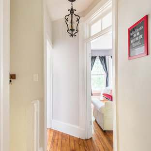 Foyer Small Contemporary Medium Tone Wood Floor Idea In Richmond With Beige Walls