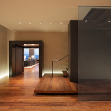 Contemporary Entry by BANKS|RAMOS Architectural Lighting Design
