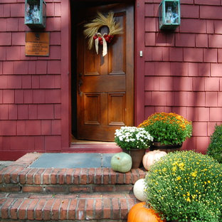 Entryway - farmhouse entryway idea in New York with a medium wood front door