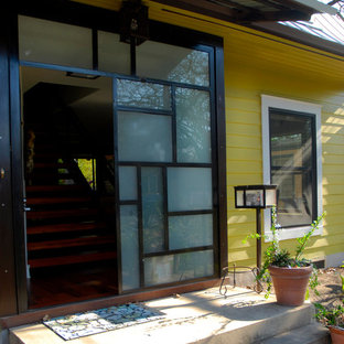 Example of a trendy entryway design in Austin with a glass front door