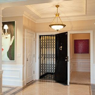 Trendy marble floor entryway photo in Boston with beige walls