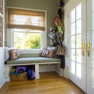Elegant medium tone wood floor entryway photo in San Francisco with a glass front door