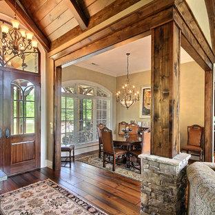 Large arts and crafts dark wood floor entryway photo in Atlanta with beige walls and a dark wood front door