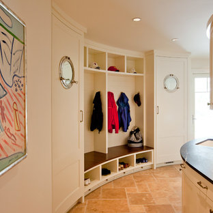 Coastal travertine floor entryway photo in Boston with white walls and a white front door