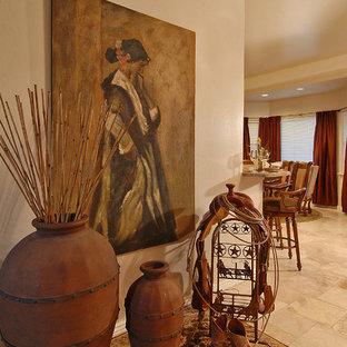 Mountain style ceramic floor foyer photo in Phoenix with beige walls