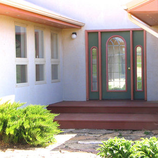 Entryway - mid-sized southwestern entryway idea in Other with a green front door