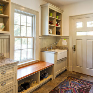 Inspiration for a timeless entryway remodel in New York with beige walls