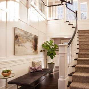 Inspiration for a large timeless dark wood floor foyer remodel in New York with white walls and a white front door