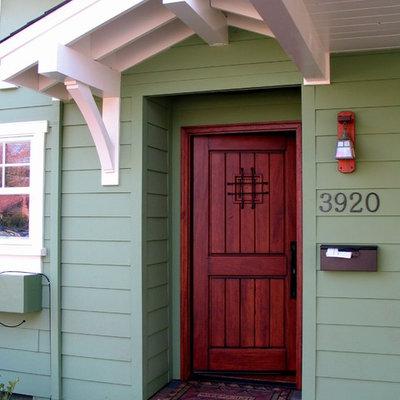 Entryway - craftsman entryway idea in San Francisco with a dark wood front door