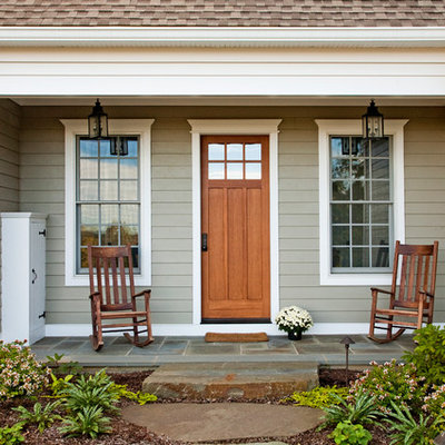 Country entryway photo in Philadelphia with a medium wood front door