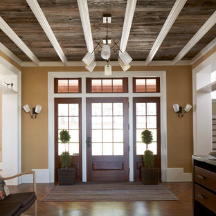 Inspiration for a mid-sized contemporary medium tone wood floor entryway remodel in New York with yellow walls and a medium wood front door