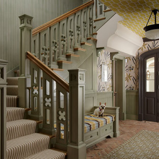 Inspiration for a timeless brick floor entryway remodel in Miami with multicolored walls and a dark wood front door
