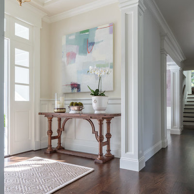 Example of a mid-sized classic dark wood floor entryway design in San Francisco with beige walls and a white front door