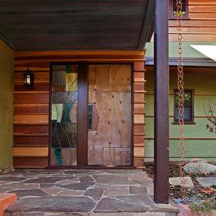 Стильный дизайн: прихожая в современном стиле с металлической входной дверью - последний тренд