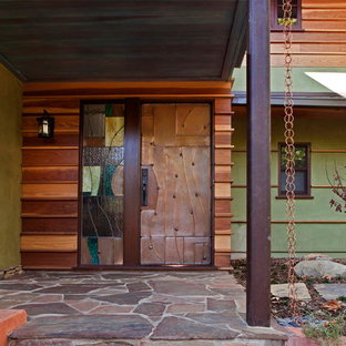 Example of a trendy entryway design in Los Angeles with a metal front door