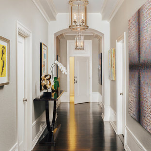 Inspiration for a mid-sized timeless dark wood floor and brown floor entryway remodel in San Francisco with beige walls and a white front door
