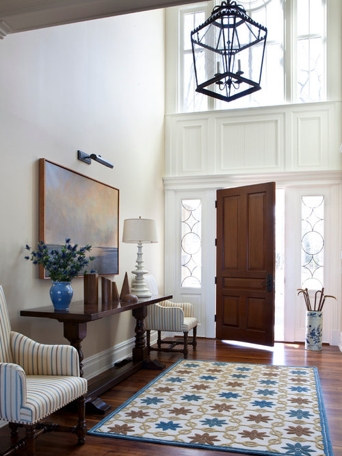 Example Of A Mid Sized Classic Dark Wood Floor Entryway Design In New York With