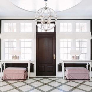 Example of a large eclectic marble floor and multicolored floor entryway design in Chicago with black walls and a dark wood front door