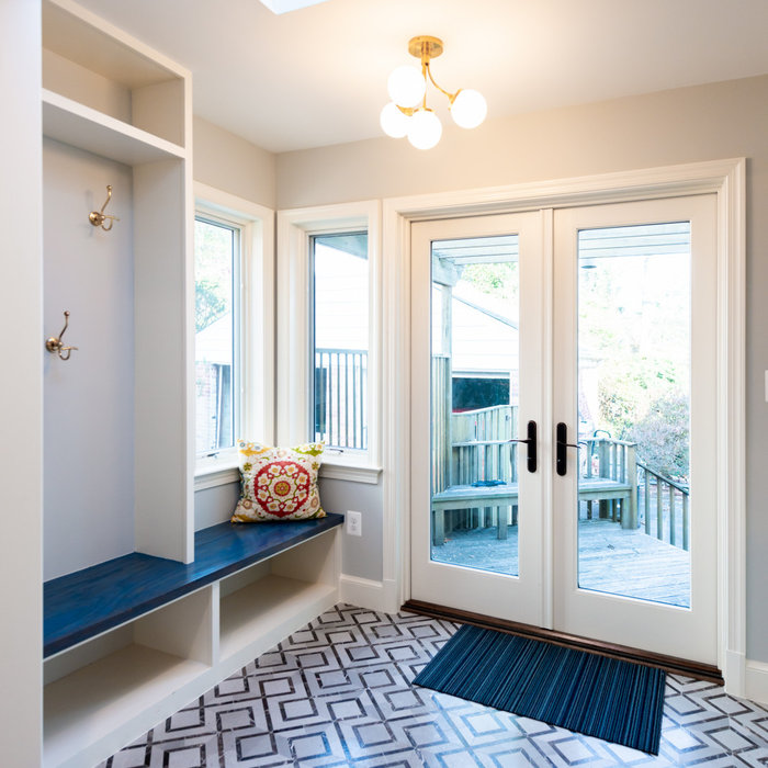 The former breakfast room was converted to a new Mudroom with storage space and a stunning floor tile.